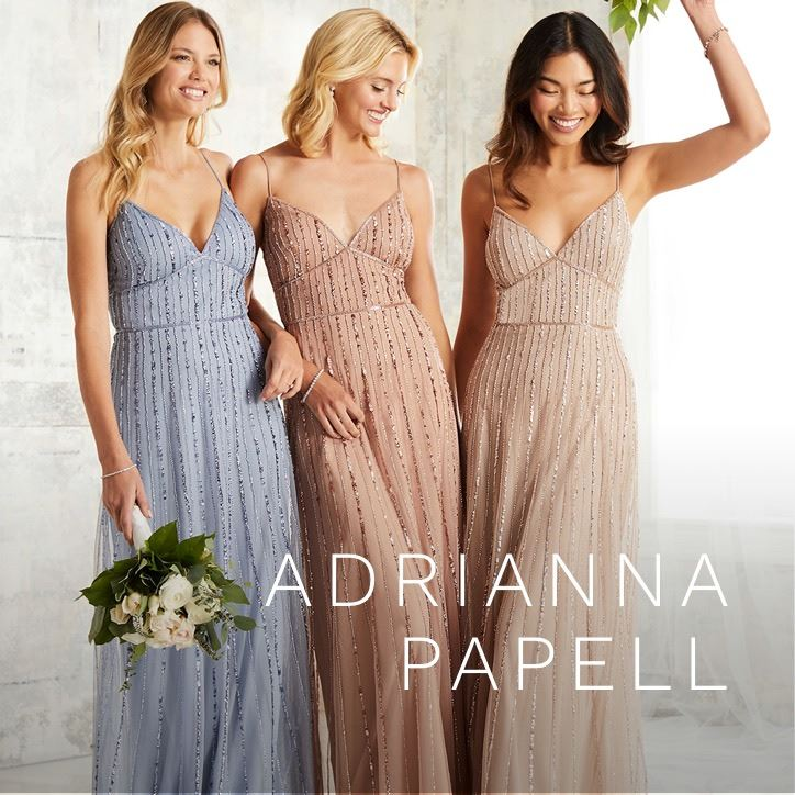 Three Bridesmaids Wearing Long Dresses